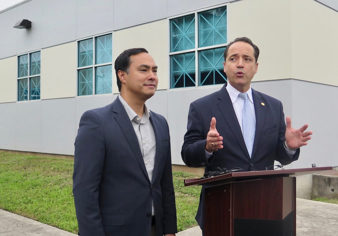 After reports of long lines and technology malfunctions, U.S. Rep. Joaquín Castro (D-Texas) and State Sen. José Menéndez (D-San Antonio) speak to reporters outside of Las Palmas Public Library on the first day of early voting.
