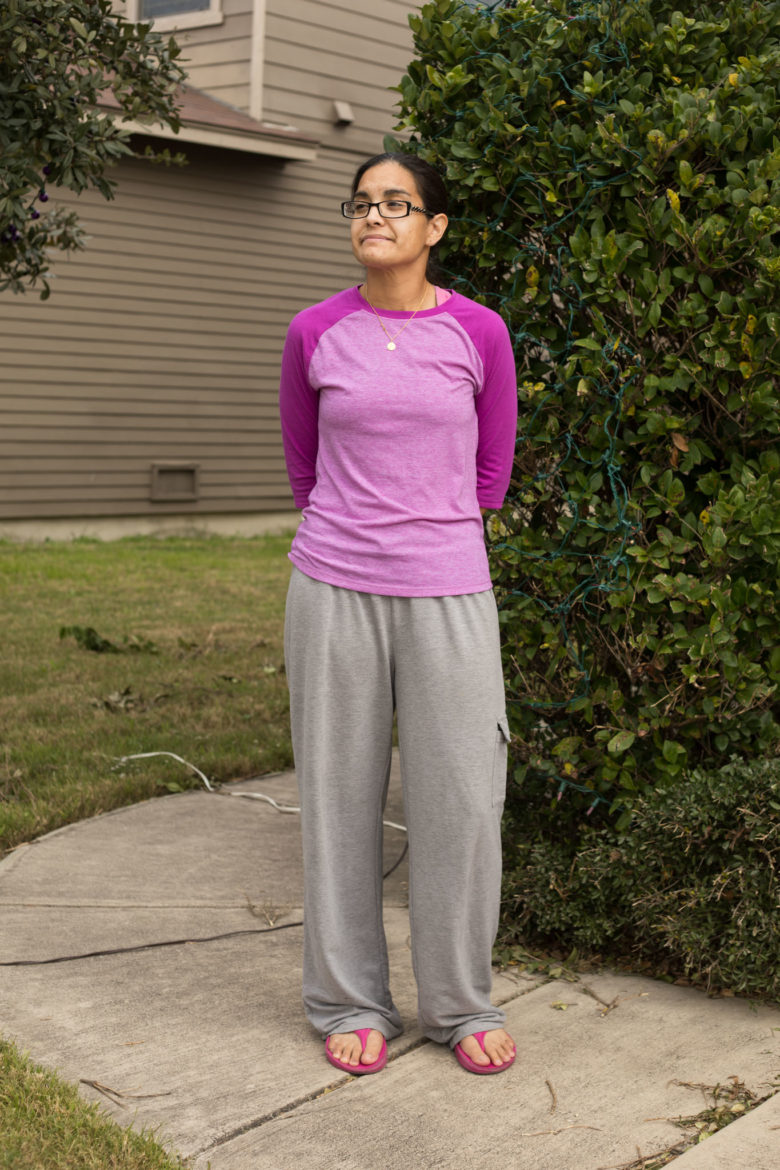 Analicia Martinez-Foley stands outside of her home.