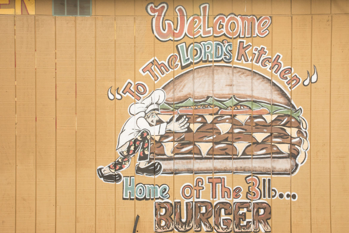 Signage next to the entrance of The Lord's Kitchen.