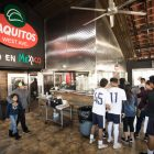 A line forms at 10 a.m. on a Saturday at Taquitos West Avenue.