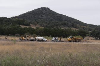 Construction equipment sits at the site of a youth camp under development near Tarpley.