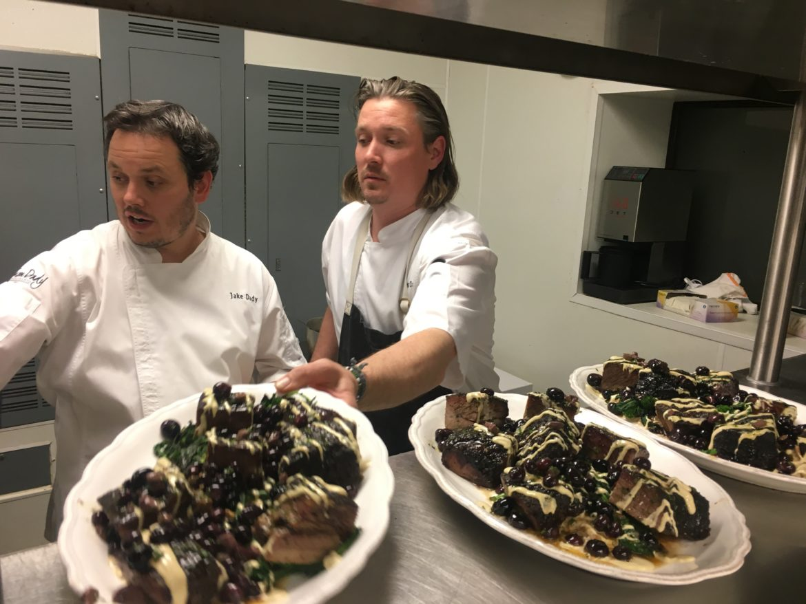 (From left) Chef Jake Dady and Chef Jason Dady prepare beef short rib with smoked oyster aioli during first of two Tricentennial Culinary Exchange dinners at New Orleans' SoBou Restaurant.