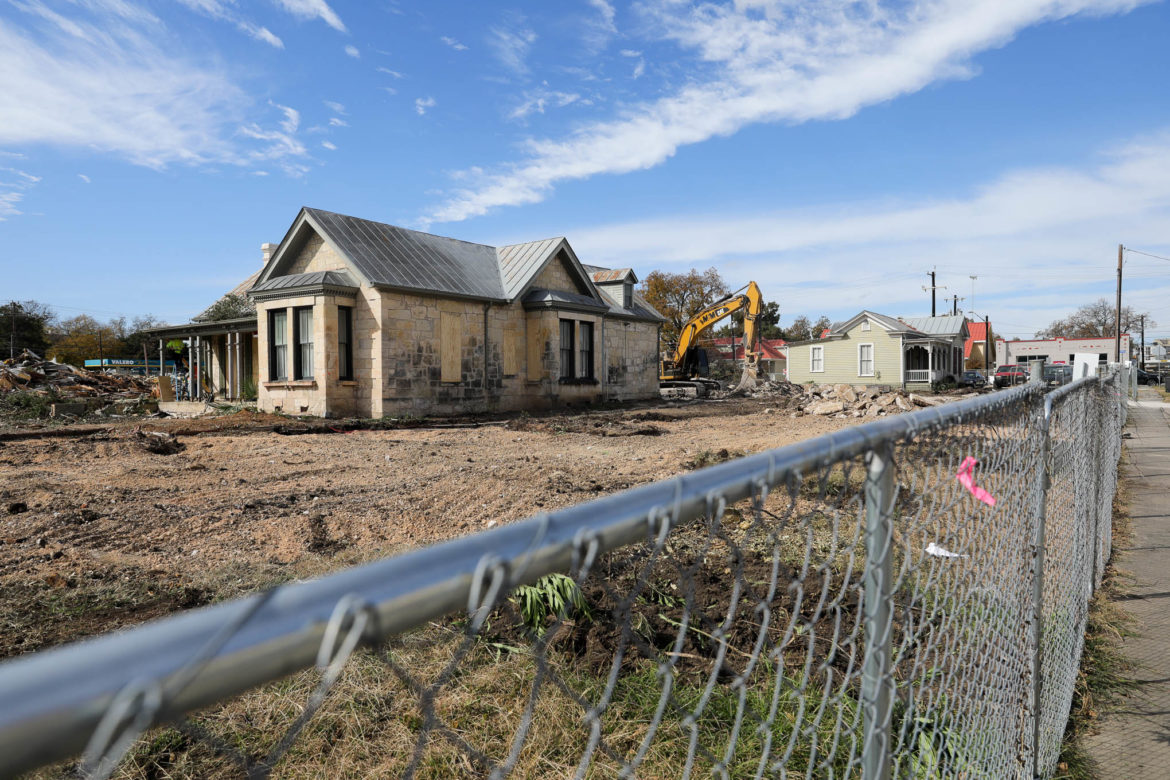 The limestone King House stands as its surroundings on the Bright Shawl property were demolished making way for a five story multi-family complex.