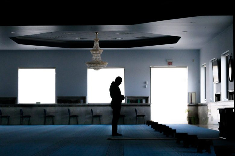 A man stands and prays in the prayer room at the Islamic Center of San Antonio.