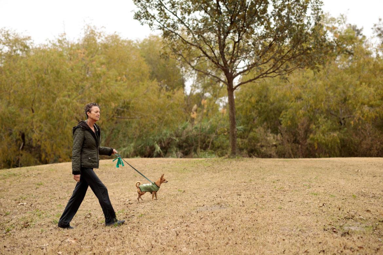 Sharon Sander walks her dog Peter Max through Brackenridge Golf Course.