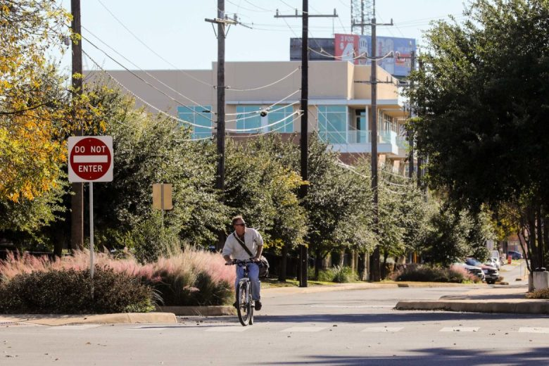 A cyclist travels along Avenue B heading North parallel to Broadway.