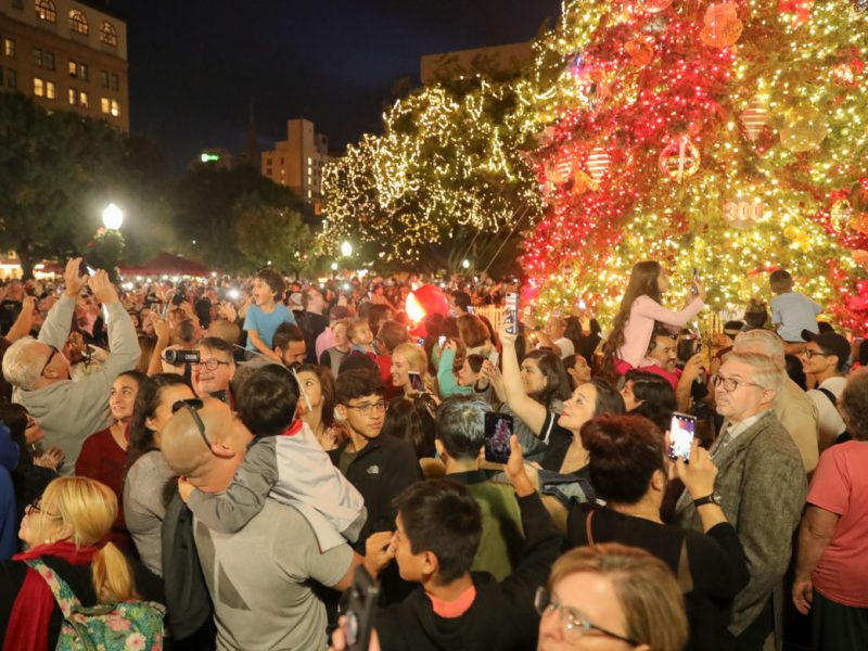 Thousands of people surround the 50 foot holiday tree at Travis Park.