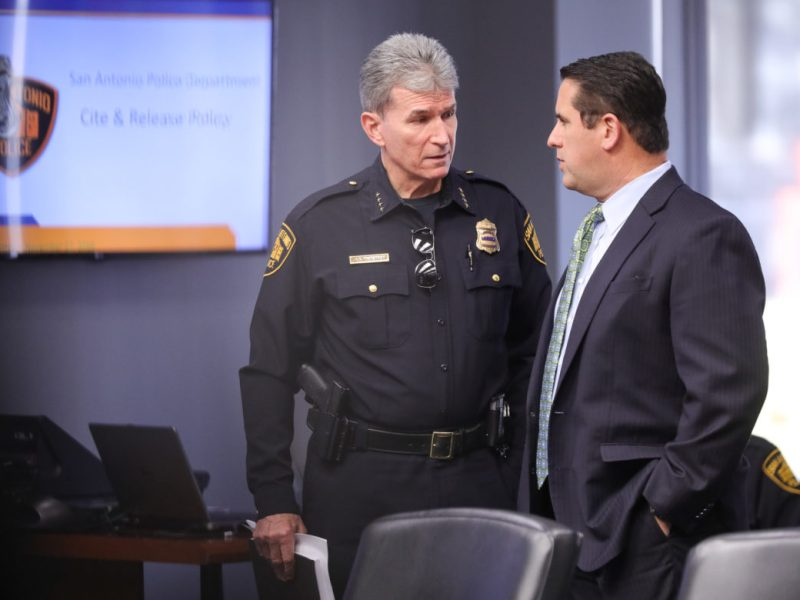 SAPD Chief William McManus (left) speaks with Deputy City Manager Erik Walsh prior to his presentation on the cite-and-release policy.