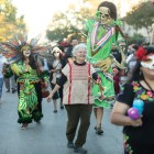 Graciela Sanchez, director of the Esperanza Center, dances in the middle of the procession.
