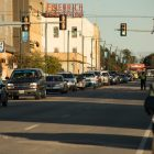 A long line of vehicles cruises down Commerce Street.
