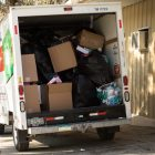 A rented white U-Haul is packed full of Christmas toys and clothing to donate.