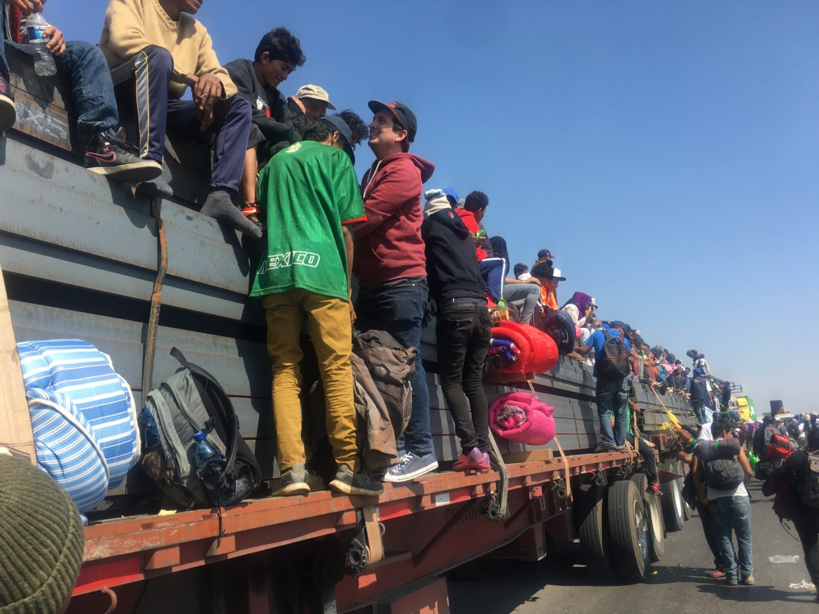 Rev. Gavin Rogers joined up with his friends on the caravan in Santiago de Querétaro. He hopped on board when the semi pulled up at a tollbooth station and allowed migrants to travel further north toward Guadalajara on Nov. 10, 2018.