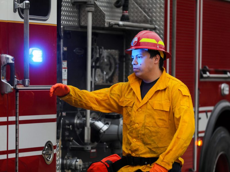 A firefighter works through a simulated call during a an urban fire training session.