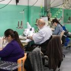Employees use sewing machines that are modified so people who are visually impaired can use them.