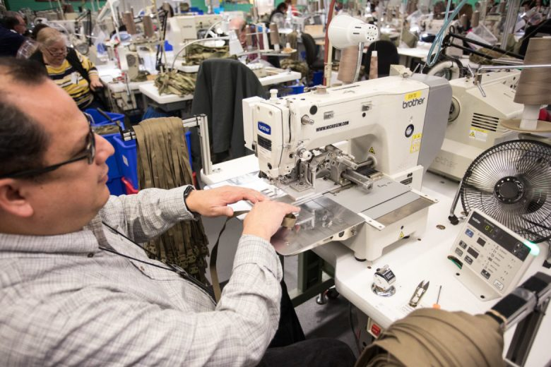 Ernest Arce works in the sewing department, helping to create fireproof tactical pants worn by military service members.