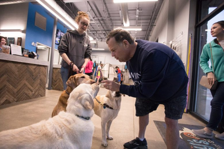 David Seldner greets his three dogs after a day of daycare.