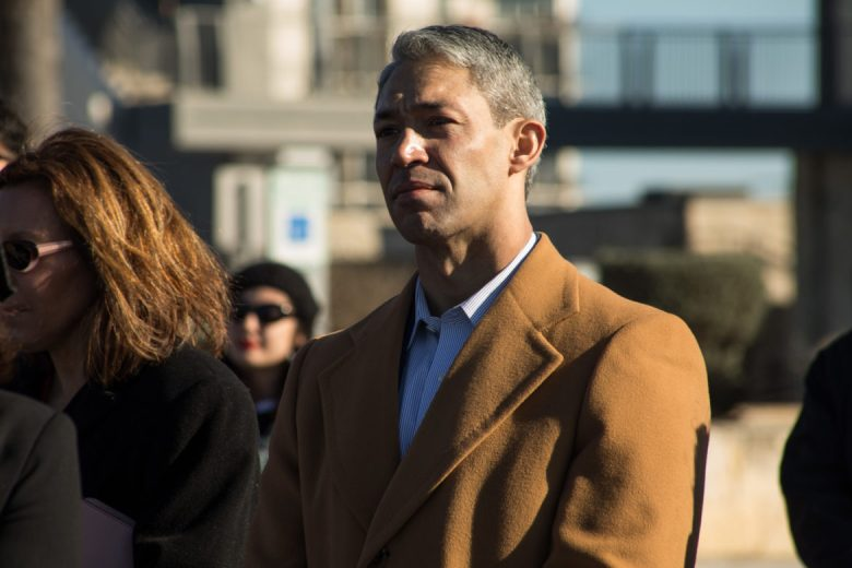 Mayor Ron Nirenberg listens to his wife Erika Prosper speak on his behalf at his re-election campaign announcement.