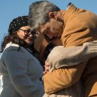 Mayor Ron Nirenberg (right) hugs his son Jonah as his wife Erika Prosper looks on.