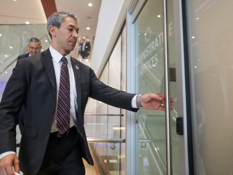 Mayor Ron Nirenberg opens the door to the administrative offices where applicants will be interviewing for the position of City Manager.