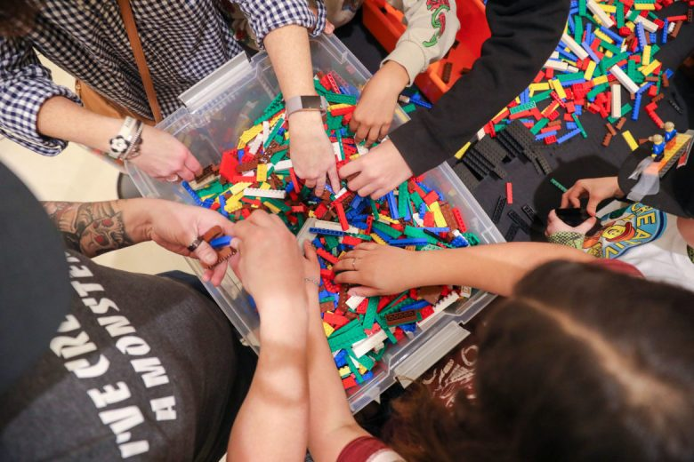 Builders dive into large tubs of Lego as the competition begins.