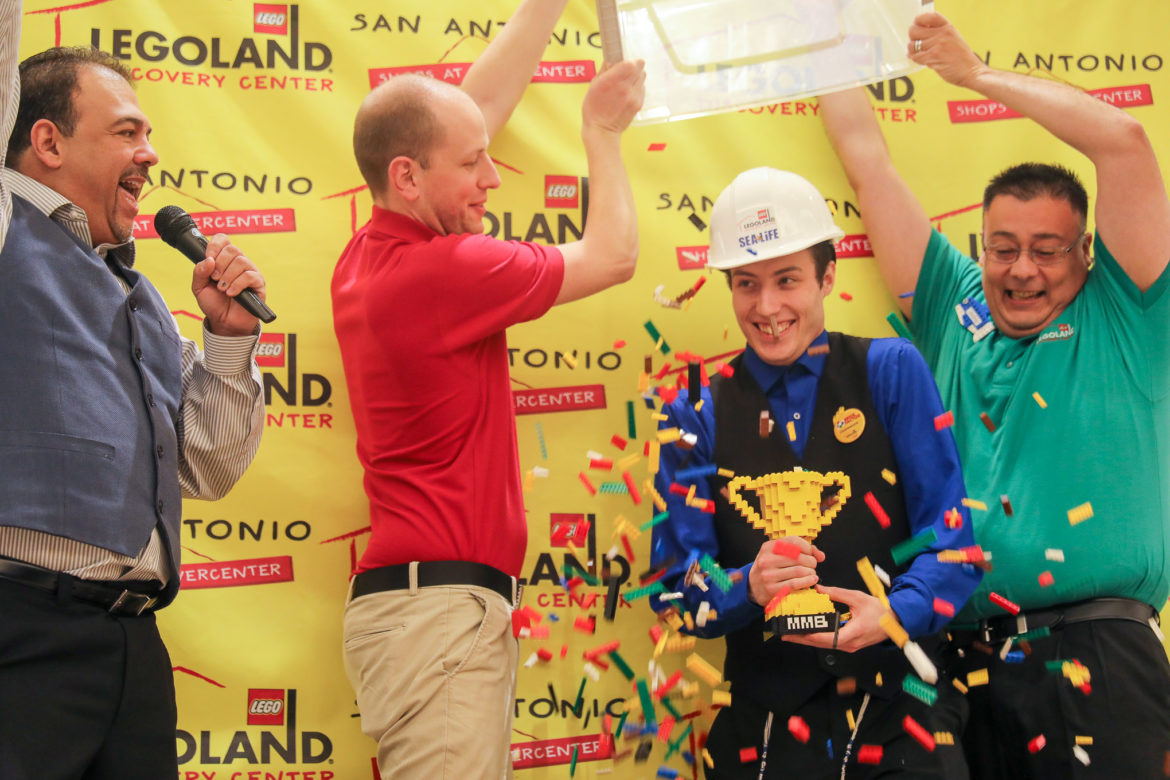 Lego bricks are poured onto winner Kevin Hintz following the announcement.
