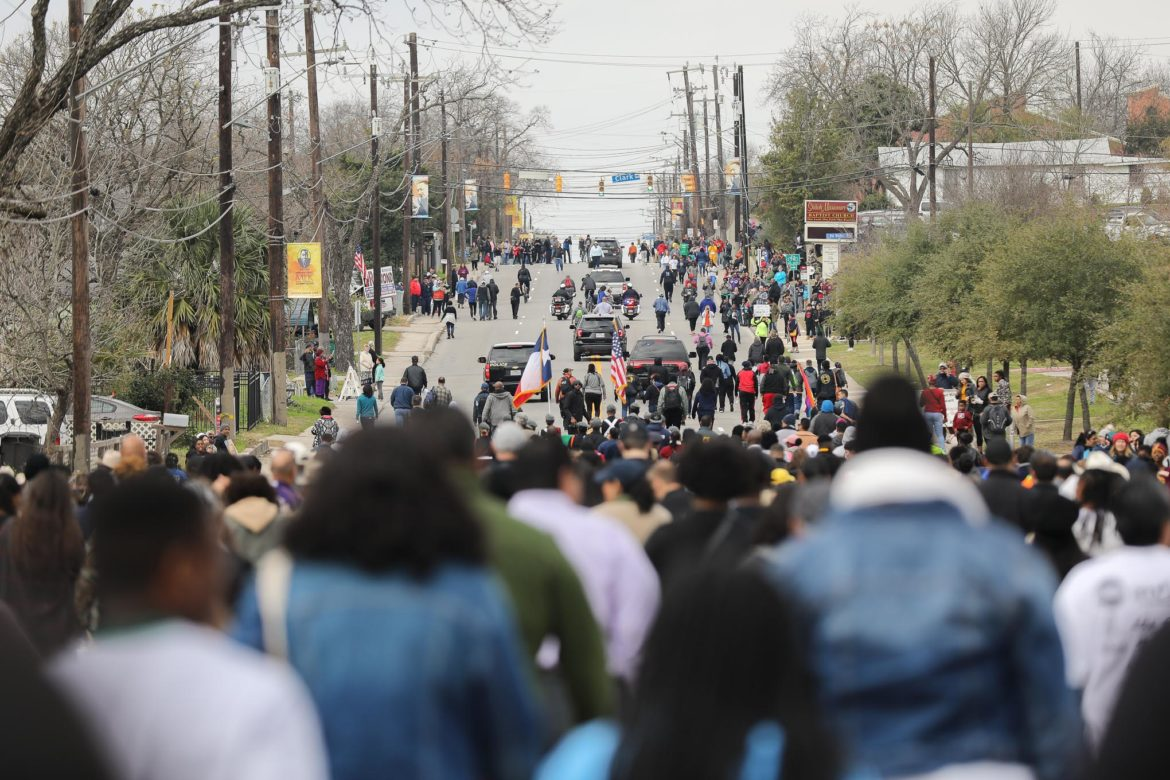 The front of the march heading West on Martin Luther King Drive.