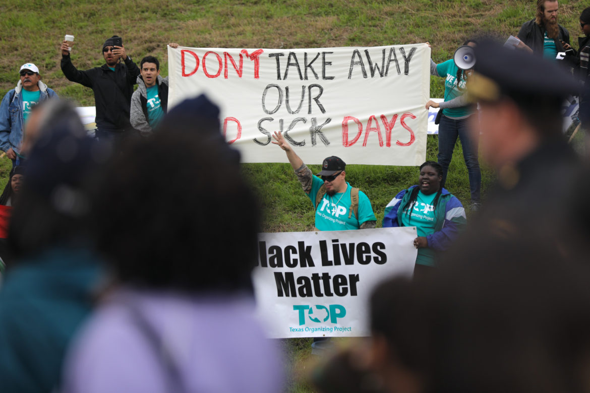 Members of the Texas Organizing Project protest opposition to paid sick leave.