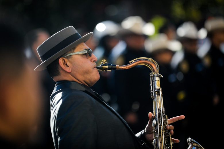 A saxophone plays outside San Fernando Cathedral before the funeral begins.