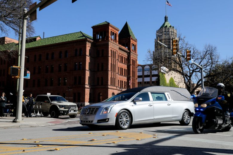 Te hearse carrying Paul Elizondo passes by the Bexar County Courthouse.