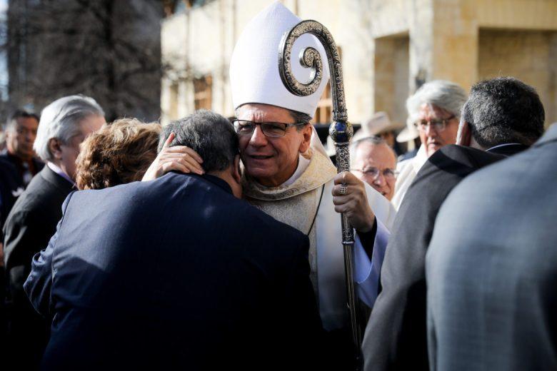 Archbishop Gustavo García-Siller hugs the family of Paul Elizondo.