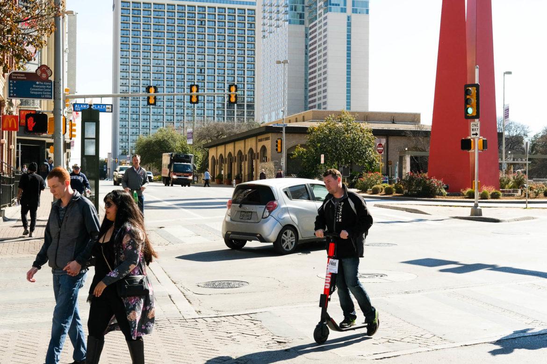 Scooter traffic along San Antonio along Commerce Street.