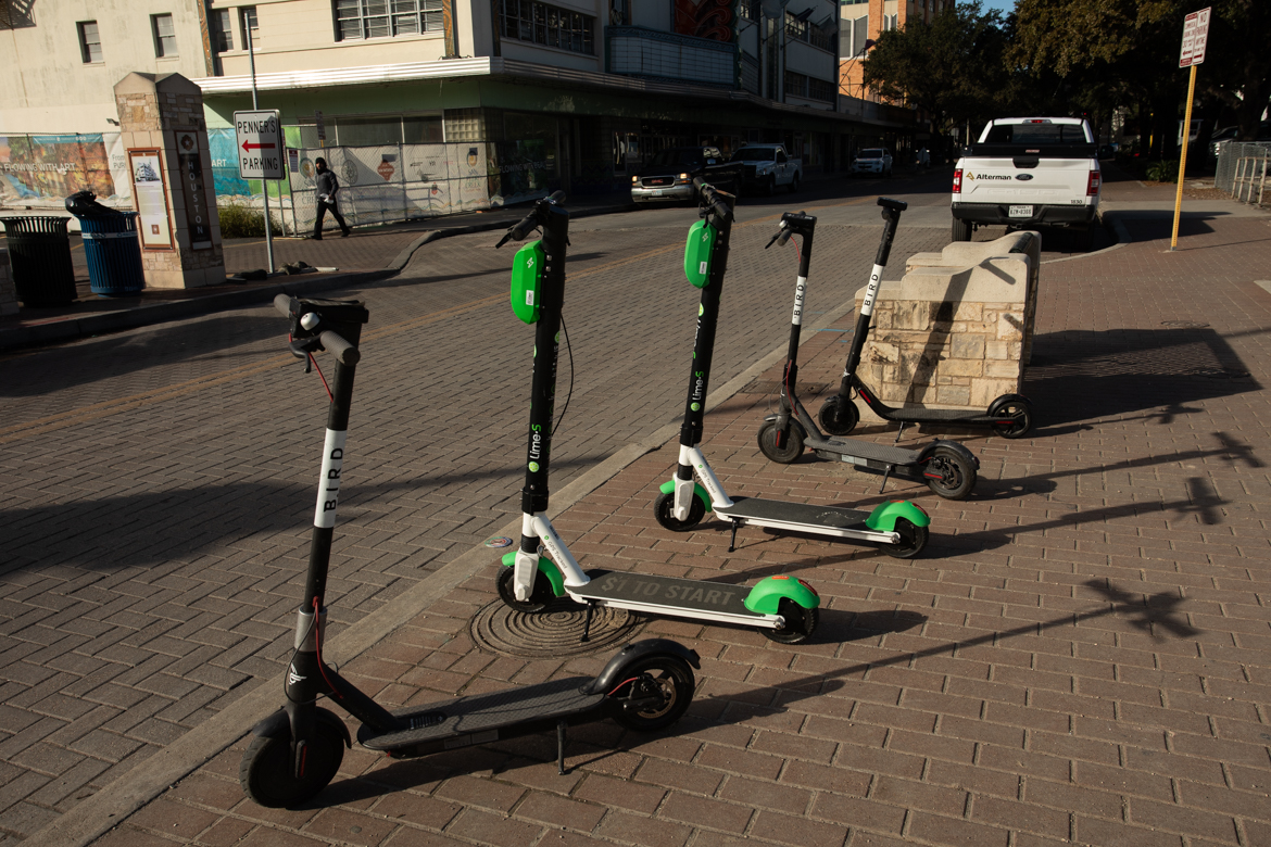 Scooters are lined up across the street from Alameda Theatre.