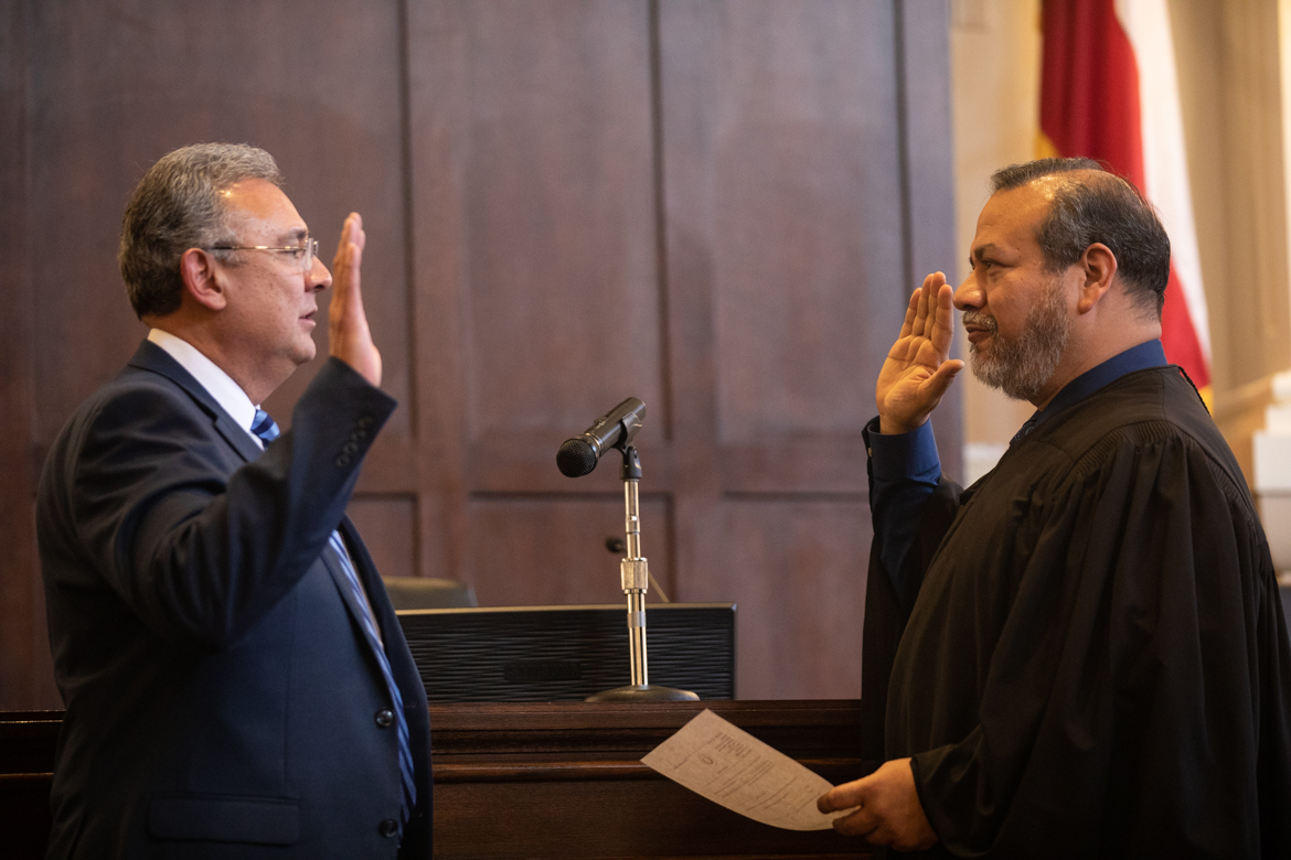 Joe Gonzales (left) is sworn in as Bexar County Criminal District Attorney by Judge Ron Rangel of the 379th Criminal District Court.