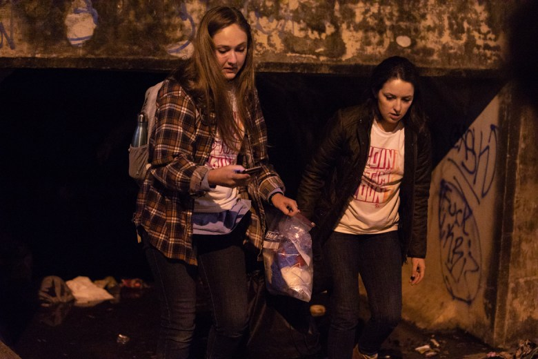 (From left) Kaleigh Longcrier and Hailey Gaskamp emerge into the drainage ditch from the tunnel under the highway.