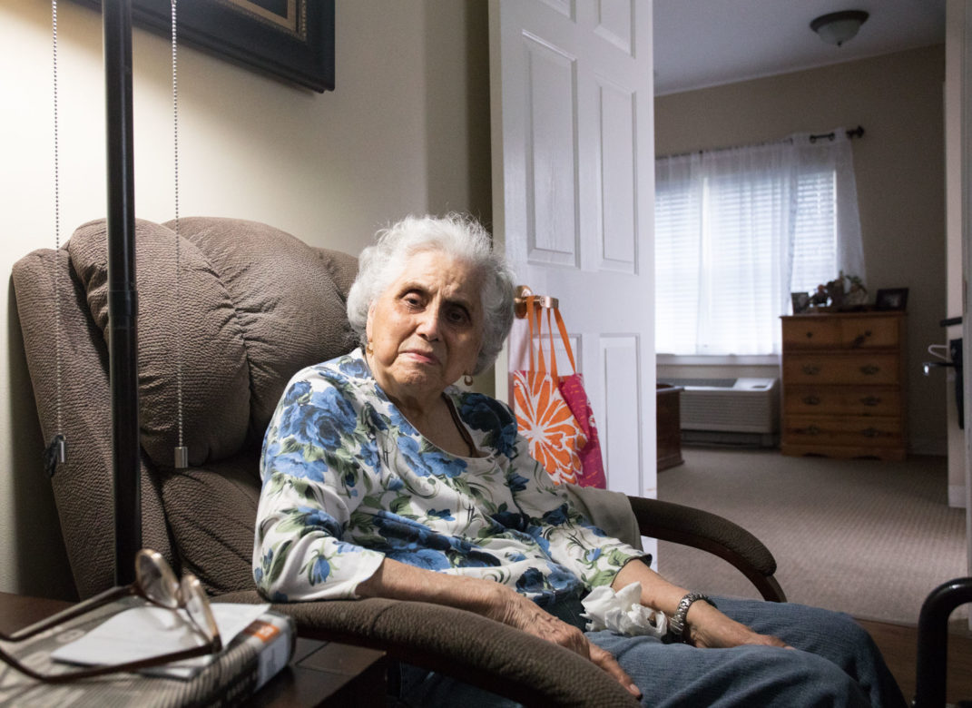 Resident Olga Solis relaxes in her room.