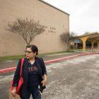 Mayra Juarez-Denis walks in front of Abraham Kazen Middle School before block walking the neighborhood.