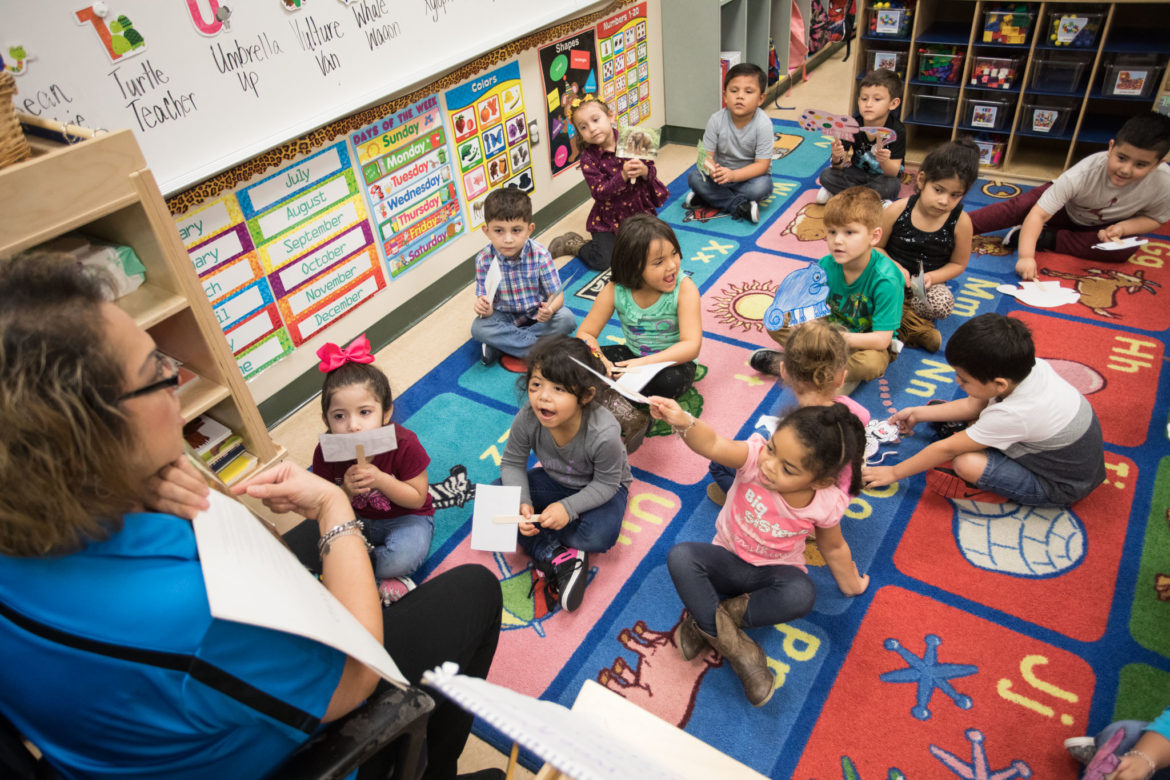 Spicewood Park Elementary pre-k teacher Nancigail Arguello reads a book to her class.