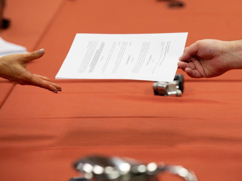 City representatives sign documents to agreeable terms between the City and the Professional Firefighters Association.