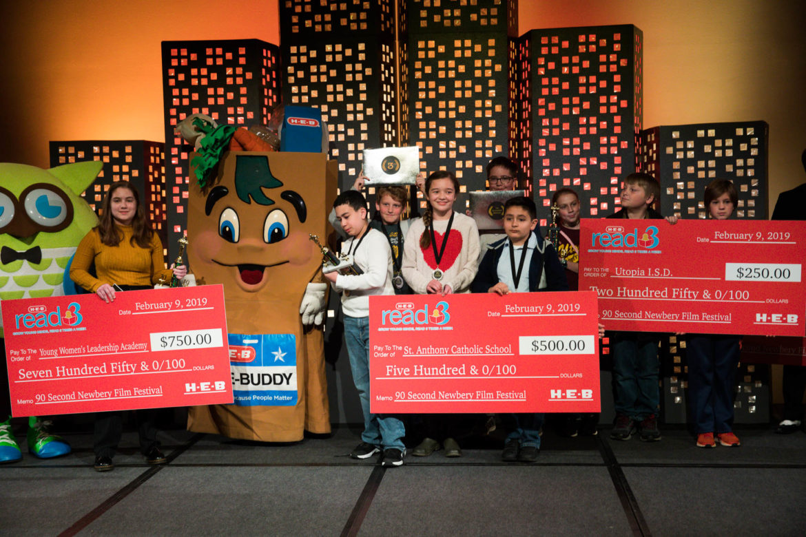 Winners of Newbery San Antonio Film Festival gather with winnings that will help fund their schools during the 90-Second Newbery Film Festival at the Witte Museum.