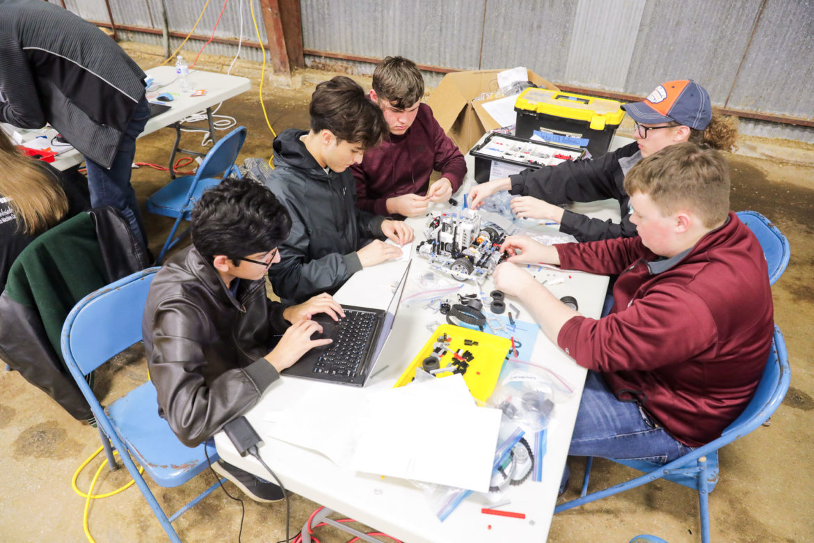 A team of students work together to tackle their objective during the competition.