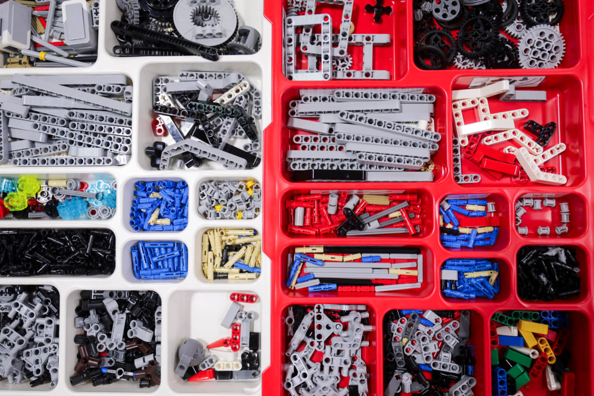 Lego Mindstorm pieces sit in trays ready to be used in the robotic inventions.