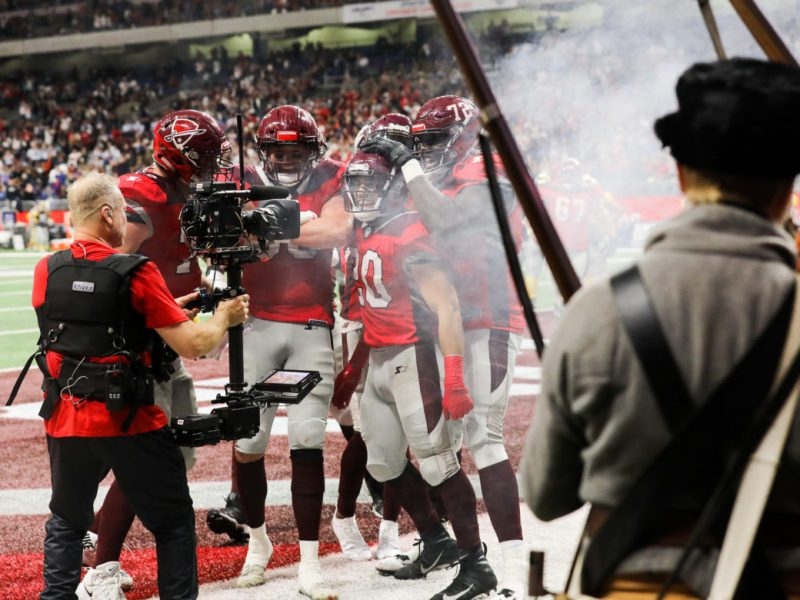 Commanders players celebrate following a touchdown against the San Diego Fleet in the first game of the league on February 9th.
