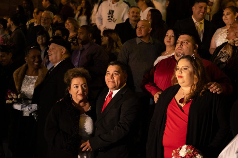 Rosie and Fidencio Esparza (lower middle) stand at the front of the Bexar County Courthouse steps minutes before midnight.