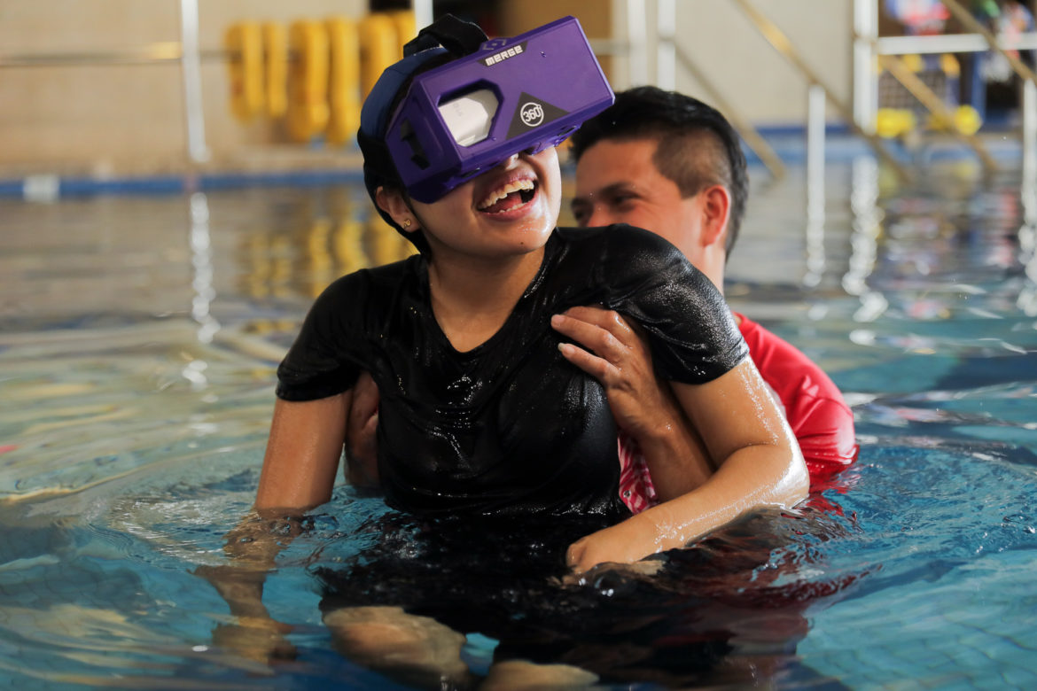 Jesus Castillo helps his daughter Karina jump into the air during the simulation.