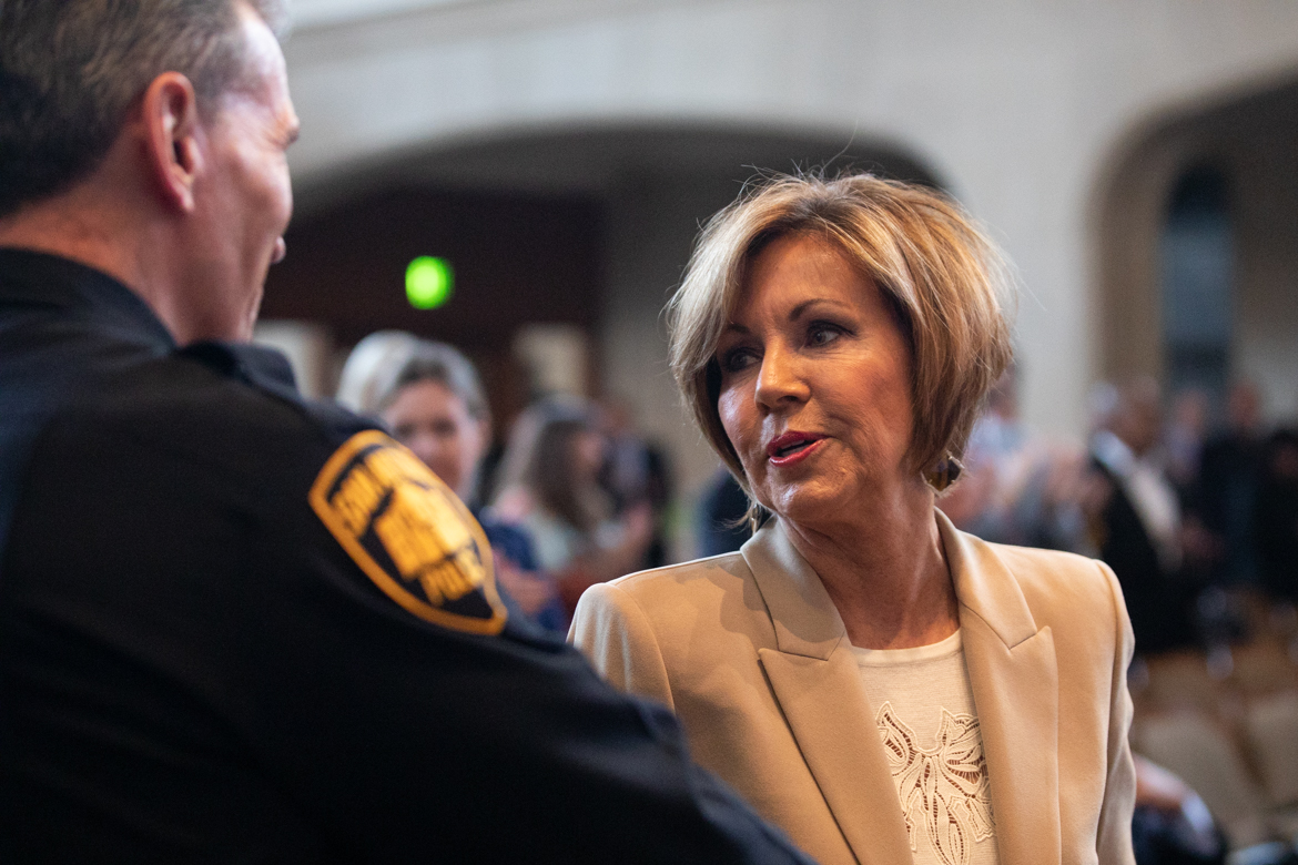 Outgoing City Manager Sheryl Sculley (right) greets San Antonio Police Chief William McManus after giving a speech.