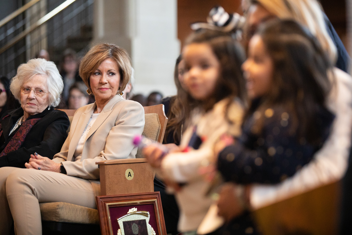 Outgoing City Manager Sheryl Sculley smiles at children in the Pre-K 4 SA who present her with a painting.