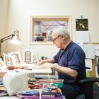 Artist Roch Banin has worked at Cavallini for 42 years.