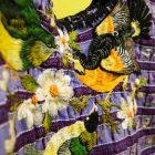 A bird detail of textiles on display.