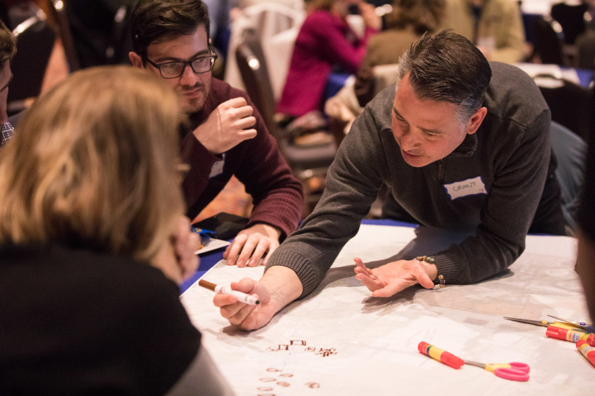 Grant Stewart works with his group to create the vision for Tower Park by visually mapping out possibilities.