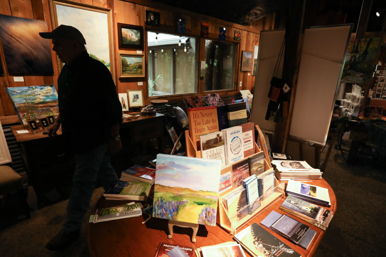 A man walks past books for sale at Las Almas.